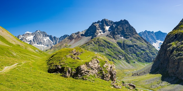 Mountain landscape on the french alps, massif des ecrins. scenic rocky mountains at high altitude with glacier