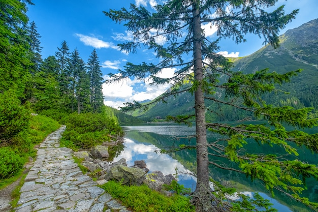 Mountain landscape with hiking trail and view of beautiful lakes