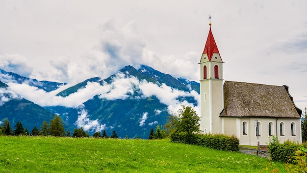 Mountain landscape with little church in the austrian alps