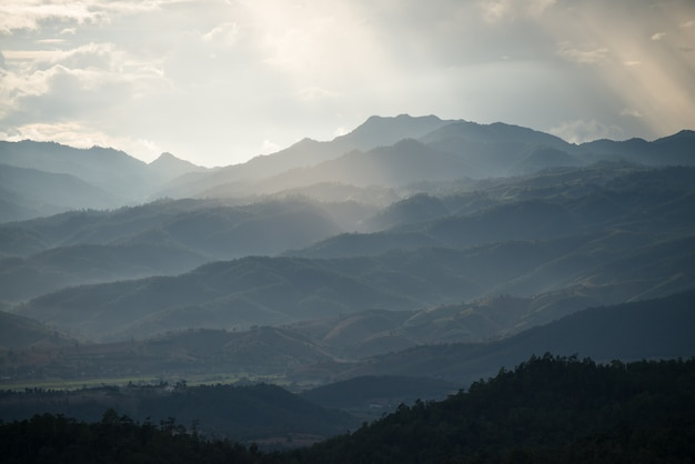 Mountain layer with sun light ray in chiang mai thailand