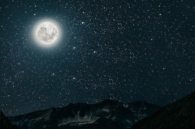 Mountain night sky with stars and moon and clouds