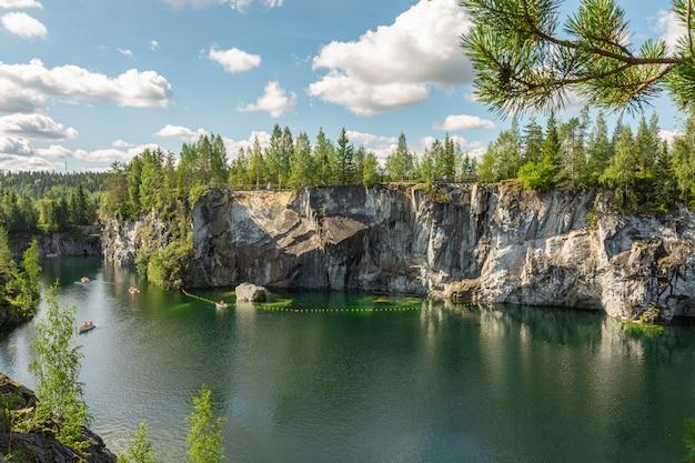 Mountain park ruskeala with beautiful green lake in karelia in mid-summer.