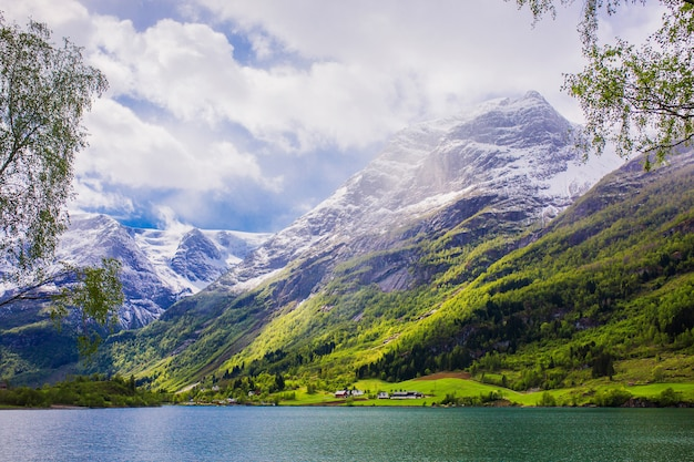 Mountain peaks in snow. picturesque landscape. fjord in norway. natural wallpaper. mountain scandinavian landscape. spring background