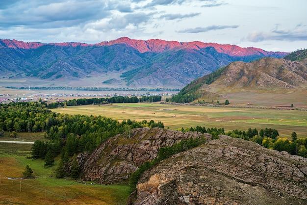 Mountain range lit by sunset light russia mountain altai ursul river karakol and kurota villages