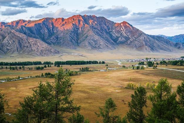 Mountain range lit by sunset light russia mountain altai ursul river karakol village