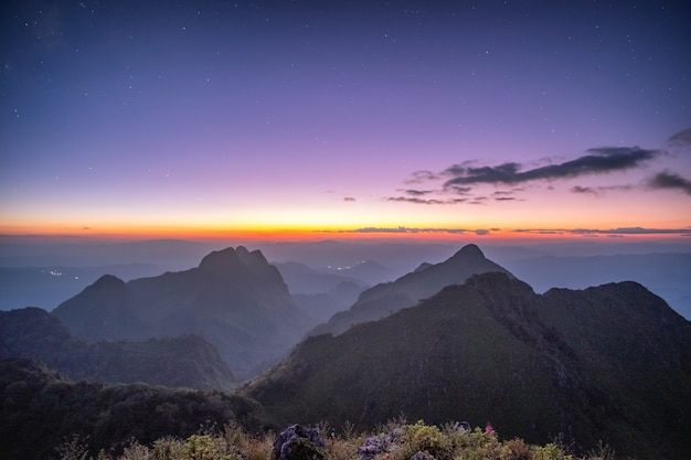 Mountain range with stars in twilight at wildlife sanctuary. doi luang chiang dao, chiang mai, thailand