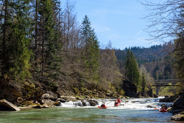 Mountain river rafting competition between teams