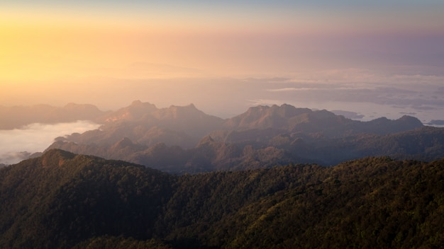 Mountain scenery with orange horizon of sunrise at khao san nok wua