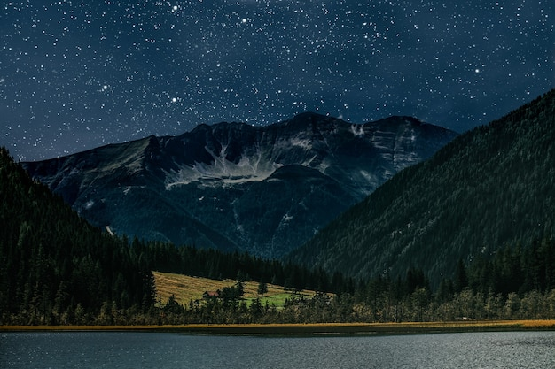 Mountain. surfaces night sky with stars and moon and clouds.  elements of this image furnished by nasa