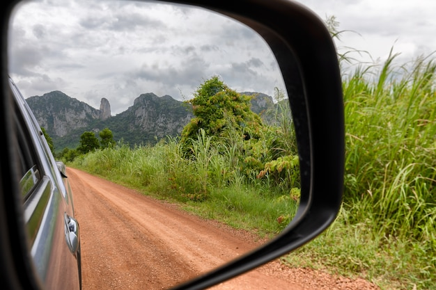 Mountain view from car mirror
