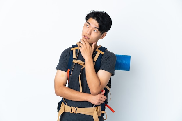 Mountaineer chinese man with on white having doubts