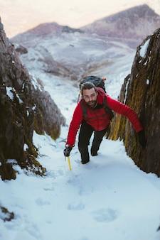 Mountaineer climbing a snow mountain