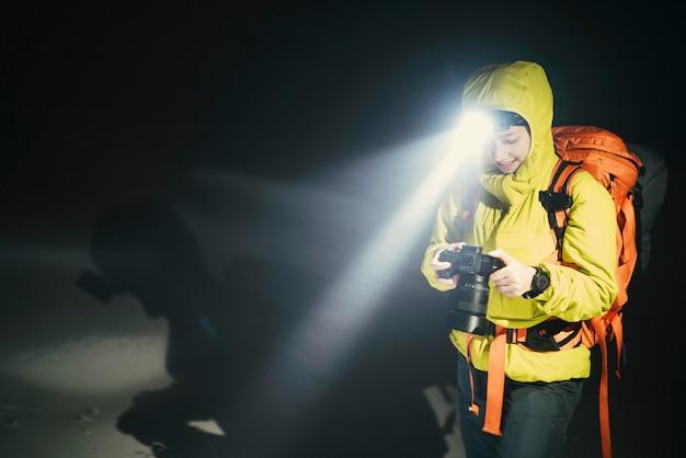 Mountaineer trekking in the cold night at glen coe, scotland