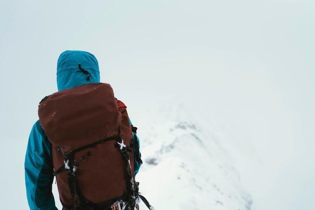 Mountaineer using an ice axe to climb forcan ridge in glen shiel, scotland