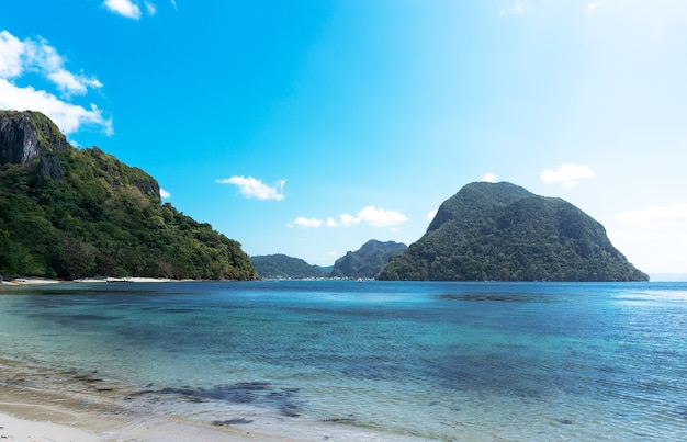 Mountains and blue water in the warm philippine sea