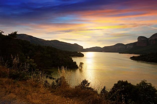Mountains lake in sunset. sau reservoir