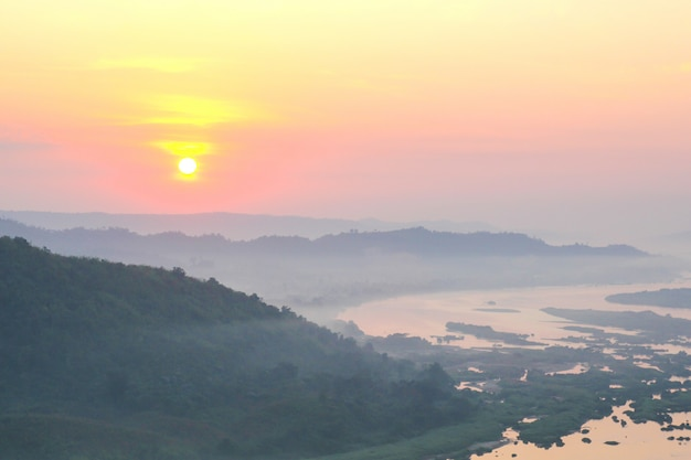 Mountains mist and sunrise view from phu huay isan in nong khai, thailand.