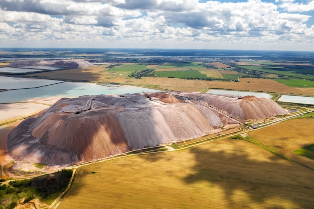 Mountains of products for the production of potash salt and artificial reservoirs.salt mountains near the city of soligorsk.production of fertilizers for the land. belarus.