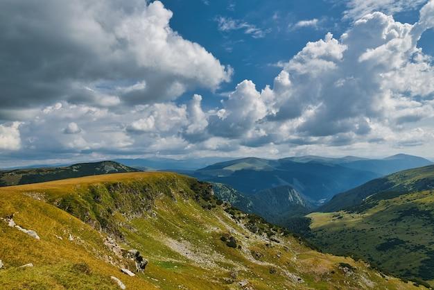 Mountains with dramatic clouds on sky, transalpina, romania