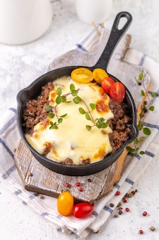 Moussaka. traditional greek dish. chopped beef or lamb meat baked with eggplants, tomatoes and cheese.