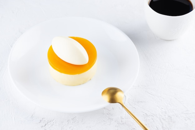 Mousse cake with mango and passionfruit on a white plate