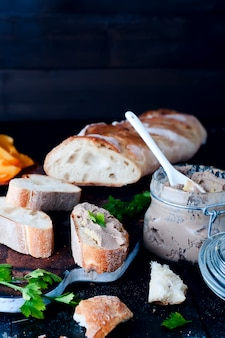 Mousse, pate in a jar with  baguette and parsley