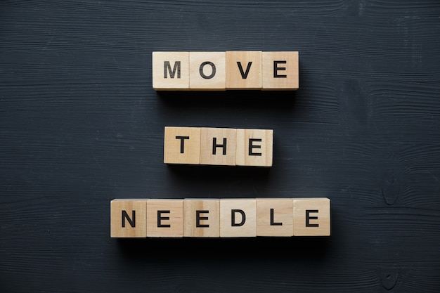 Move the needle on wooden blocks