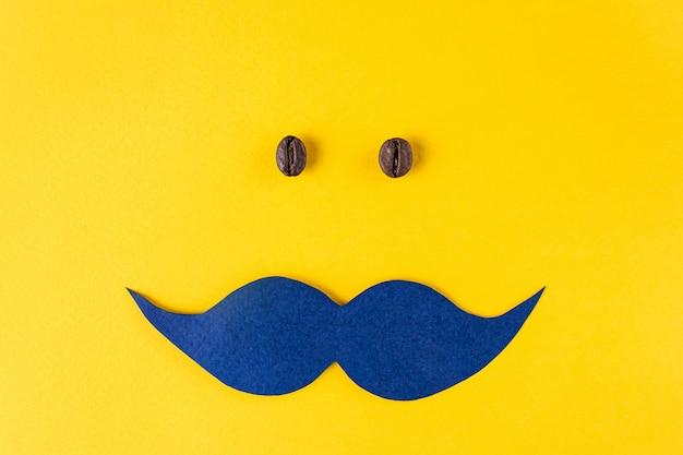 青い口ひげとmovemberコンセプトのコーヒーの穀物