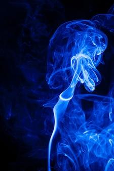 Movement blue smoke on black background.