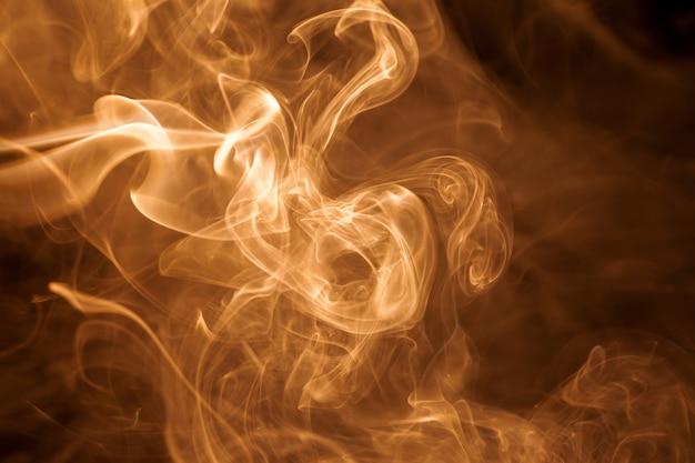Movement gold smoke on black background.