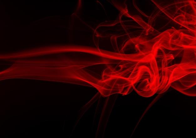 背景の黒に赤い煙の抽象の動き