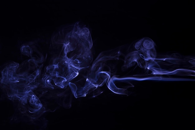 Movement of purple smoke abstract on black background