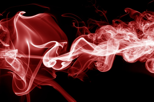 Movement of red smoke on black background.