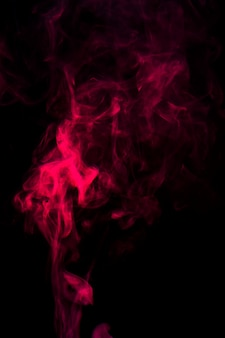 Movement of red smoke spread on black background
