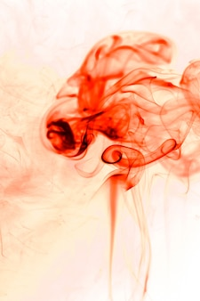 Movement red smoke on white background.