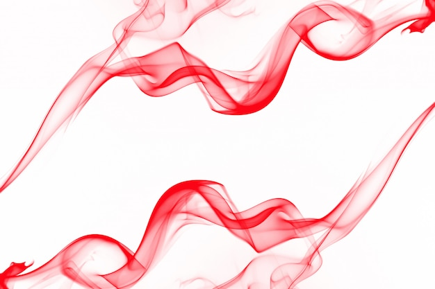 Movement of smoke abstract isolated on white background, red ink water