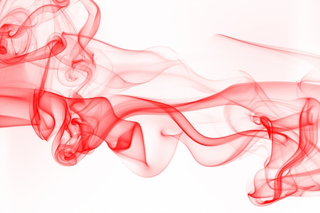 Movement of smoke, abstract red smoke on white background, ink water