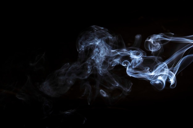 Movement of white smoke on black background for art design