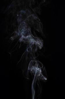 Movement of white smoke on black background