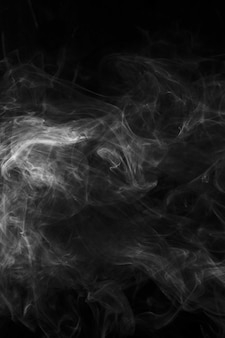 Movement of white smoke textured on black background for art design