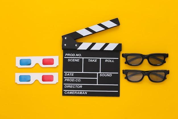 Клаппер кино и 3d-очки на желтом. развлекательная индустрия. кино