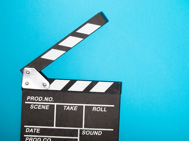 Movie clapper board on blue