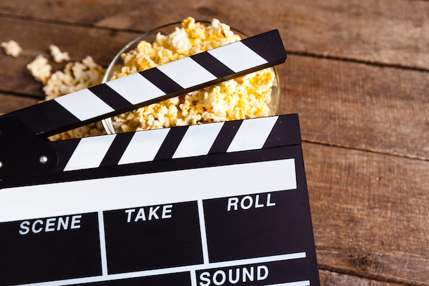 Movie clapper board and pop corn