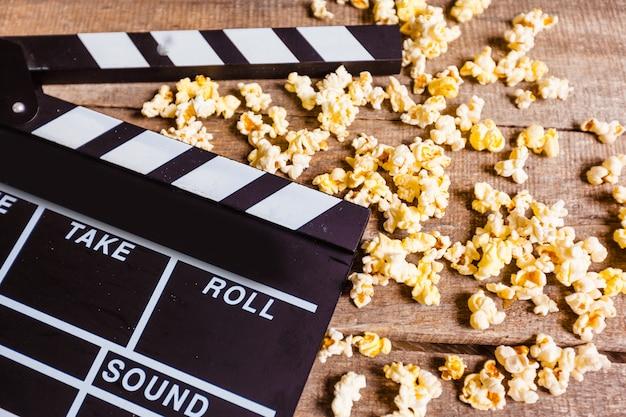 Movie clapper board and pop corn