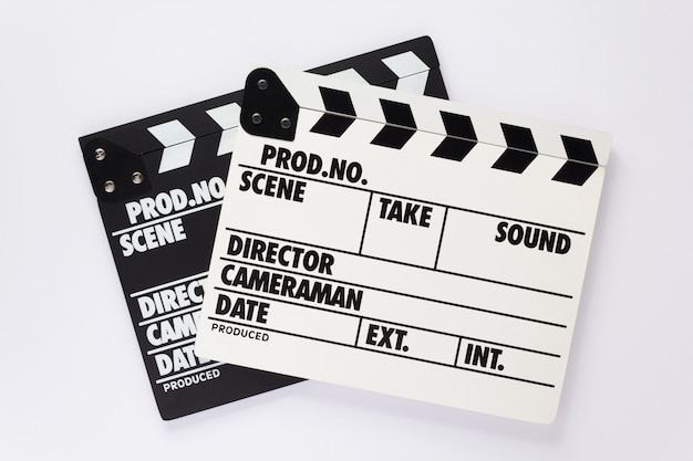 Movie clapper board on white  background, top view
