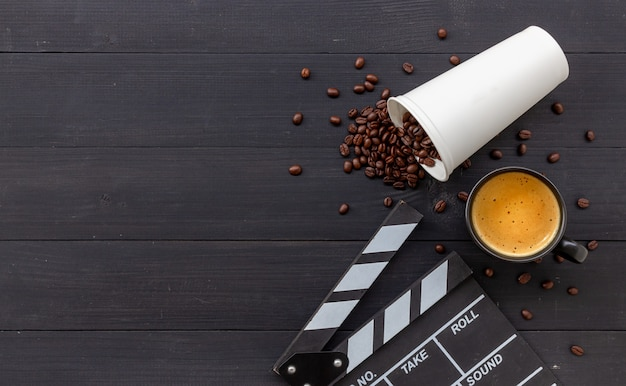 Movie clapper, hot coffee and beans