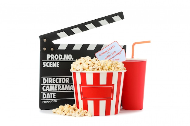 Movie clapper, paper cup, bucket with popcorn and tickets isolated on white background