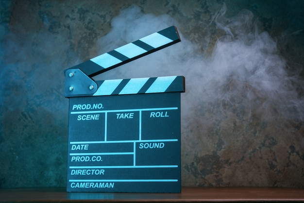 Movie clapperboard in blue light