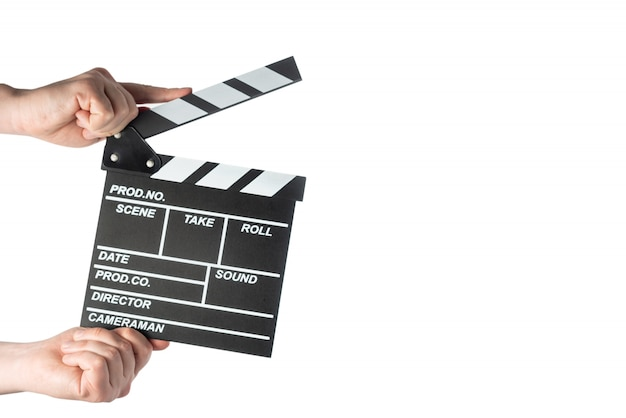 Movie clapperboard in hands on white isolated space