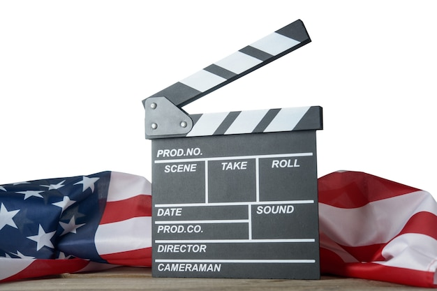 Movie clapperboard with american flag on the table